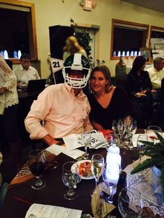 Greg Somers and his lovely bride Melissa Somers after winning the MSU Helmet at auction at Rotary Club of Petoskey Diamonds & Denim 2015. — at Knights of Columbus.