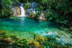 Waterfall and lake in Chapada dos Veadeiros in Goiás - Brazil Vacation Places, Dream Vacations, Places To Travel, Places To See, Brazil Beauty, Exotic Places, Belleza Natural, World Heritage Sites, Wonderful Places
