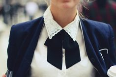 I love the delicate details on the collar combined with the tie.