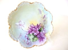 Sweet vintage flat plate is hand painted with gorgeous purple violets! They have a pastel blue, green and yellow background. The RC Monbijou Bavaria