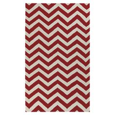 Flatweave wool rug with a Venetian red chevron motif. Handcrafted in India.  Product: RugConstruction Material: ...