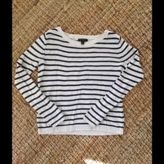 Banana republic striped sweater Nice quality banana republic striped sweater with navy and white stripes. Zip detail on both shoulders. Hits at waist. Size small Banana Republic Sweaters Crew & Scoop Necks