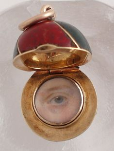 Eye miniature pendant set in Scottish agate sphere Georgian C. Blue eye miniature painted on ivory set in gold and encased in a sphere of various colors of Scottish agate. Agate Jewelry, Eye Jewelry, Victorian Jewelry, Antique Jewelry, Vintage Jewelry, Lovers Eyes, Art Nouveau, Miniature Portraits, Gothic