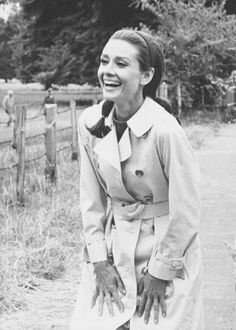A smile that lights up the world in a great classic trench coat.