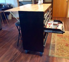 Tool box made into a kitchen island with side bar for sitting