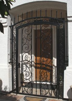 At Sun King Fencing & Gates, we manufacture and install custom decorative wrought iron gates for homes and businesses throughout the Phoenix area. Wrought Iron Security Doors, Wrought Iron Doors, Security Gates, Porch Gate, Iron Garden Gates, Tor Design, Iron Front Door, Grill Door Design, Casa Retro