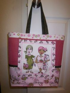 This tote is made with vinyl covered polyester screen and breast cancer awareness fabric. It is one of my favorites.
