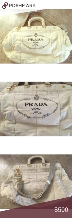 Prada Canapa vintage white denim purse Authentic Prada Canapa in white denim purse. It's very beautiful and clean inside out!! I'm ready to let it go because it's too big for me. Prada Bags Shoulder Bags
