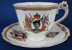This is a Radford's China, England British royal memorabilia cup and saucer commemorating the coronation in 1953 of Queen Elizabeth II of England with the Queen in her Trooping the Colour outfit with