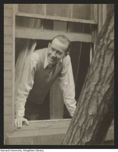 E.E. Cummings leaning out a window, photograph by Henry Dunham. MS Am 1892.11 (92) Houghton Library, Harvard University