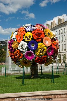 Colourful flower sculpture on Antonin Poncet square in Lyon, France. By artist Jeong-Hwa Choi