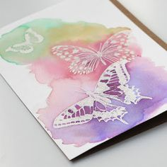 handmade card ... emboss resist with white heat embossed butterfles and a watercolor wash ... delightful!