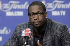 Miami Heat player Dwyane Wade rocks the geek glasses his own way – with no glass.