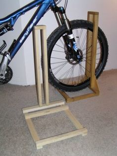 Items similar to bike stand on Etsy - workshop ideas Items similar to bike racks on etsy home made bike rack wood. The post Similar items like bike rack Pallet Bike Racks, Diy Bike Rack, Bike Holder, Bicycle Storage, Bicycle Rack, Wooden Projects, Wood Crafts, Garage Velo, Wood Bike