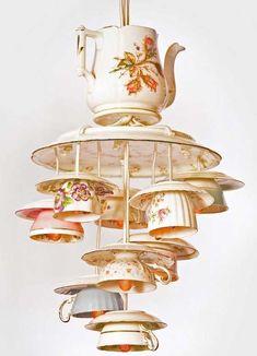 tea pot covert to chandelier - how nice idea. Someday....