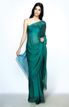 First strapless sari I've ever seen.. designed by Hermes which explains that I guess. Love the color and fabric.