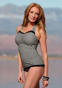 Modest Tankini Swimwear: Ruffle Square Halter in Black Gingham A-line shape that slims all body types. Shoulder flattering halter style that minimizes hips with a modest neckline. Ruffles add a touch of sassy fun to this design. Gathering in the chest offers an illusion of added fullness. Removable bra cups provided. Full support. $84.00