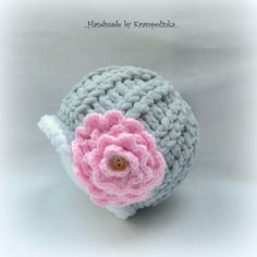 Crochet  baby beanie with pink crochet flower