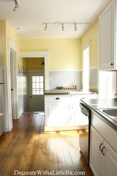 Kitchen: love the gray beadboard with yellow walls and white cabinets