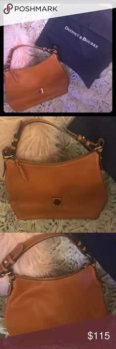 Dooney & Bourke Leather Purse Authentic Dooney & Bourke; only use a couple times. Red interior, with multiple pockets and clip for keys.   Like new; 14 by 10; adjustable shoulder strap Dooney & Bourke Bags Shoulder Bags