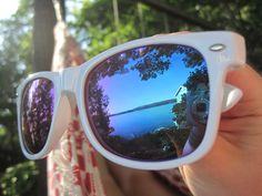 Enjoying the lake through a sunglasses eye
