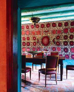 Fabulous color walls & suzani! Dining room in Catalonia designed by Spanish interior designer Ramón de Abadal. via Lush & Luxe