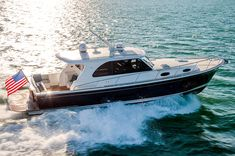 Crafted with a true yachter's sophisticated eye for detail, the Eastbay 44 downeast-style luxury yacht features a bright and spacious interior and accommodations for your whole crew. Grand Banks Yachts, Cruiser Boat, Luxury Yachts, Summer Breeze, How To Look Better, Boats, Boating, Ships, Boat