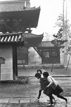 Japan. Three girls running.  Kyoto, 1965.  // © Henri Cartier-Bresson/Magnum Photos