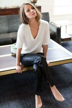 Simple chic style. Long bob, oversized cream tee and leather/leather like pants.