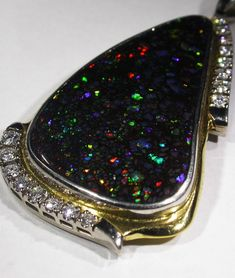 Deep blue Boulder Opal pendant with multi-colored flashes
