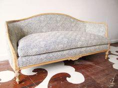 reupholstered antique sofa
