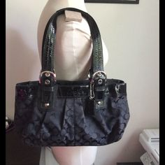 """Authentic Coach Signature C black purse  Authentic Coach Black purse, black signature C fabric, black patent leather straps, black and clean inside, silver metals. Normal wear on the fabric because of the use (nothing noticeable) Good condition, clean, no flaws. 9"""" X 17"""" X 4"""" -No trades. -No holds. -No more discounts for this bag, It is not easy to find good prices for reselling, do not ask for lower prices Please.  Click the listings to see the boutique.  Thanks for your visit ;-) Coach…"""