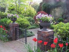 brick pillars with low wall and metal fence/gate