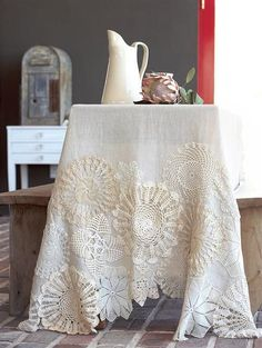 Embellish a plain tablecloth with all those doilies from wedding!