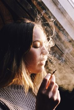 cara by Esben Bog. I was interested in the lighting on her face in this photo, as well as the stop action of the smoke and her facial expression.