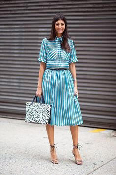 GB, yet again. striped top, striped a-line pleated skirt, ankle strap sandals and a handheld bag
