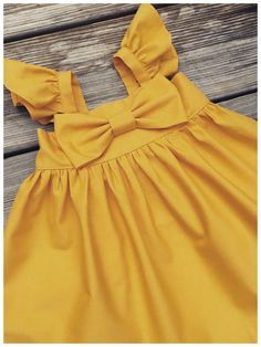 Fluffy sleeve mustard Easter dress, big bow dress, toddler Easter dresses, mustard big bow dress, newborn Easter dress, flower girls dress #toddlerfashion#affiliate