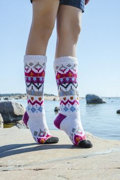 These colourwork socks are bright and modern in their flashy colouring! Why not add some colour to your wardrobe with this fun and cheerful pattern? Knitted with Novita 7 Veljestä Aran wool yarn. Crochet Socks, Knitted Slippers, Wool Socks, Knitting Socks, Knit Crochet, Knitting Charts, Knitting Patterns, Crochet Cross, Knee High Socks