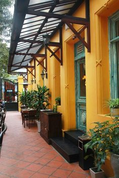 "The dark wooden sign is hung outside, saying: ""HOME – Vietnamese Restaurant"".Despite the busy lunch time coming, the gate was still closed as always and only open once I decided to come in. Situated in a villa built in French colonial style, Home could be found easily. Its bright yellowwalls and faded green windows made up an outstanding appearance, setting the restaurant apart from the humble neighborhood which surrounds Chau Long market #review #eatinginhanoi #restauraunt"