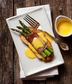 Roasted Asparagus and Prosciutto Crostini with Fontina Cheese Sauce