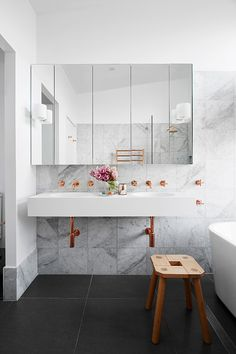 marble and copper bathroom