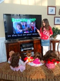This Little girl uses WATCH ME LEARN Videos to teach her DOLLS!!!!