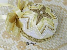 This Christmas bauble is a splendid combination of bronze sparkle ribbon, white and light yellow satin ribbon on a polystyrene bauble support, using the patchwork technique (pineapple), I sat the satin ribbon in a very interesting position to form the star in middle of ornament resulting this