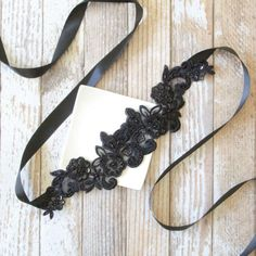 Beautiful and lovely black embroidery flower lace sash with black satin ribbon. Hand sew with black beads and sequins. Soft and romantic design