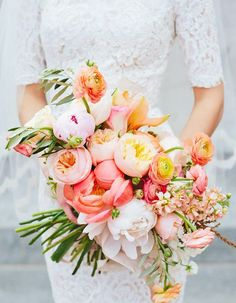 These Are Summer 17's Trendiest Wedding Bouquets - Wilkie Blog! - Cascading tropical blooms with green accents