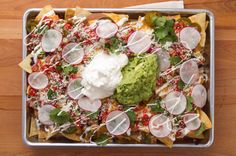 What do you call cheese that isn't yours? Nacho cheese! While cheese jokes may abound, nachos are no joke. You can't go wrong with bathing crispy tortilla chips in cheesy sauce and loading them up with toppings—nachos are a natural choice when snack time (or game day) rolls around. There are infinite tasty iterations; here are 15 nacho recipes to see you through the Super Bowl.