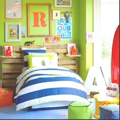 Green and blue color scheme. I like the idea of using old pallets on the wall. gives it some character!