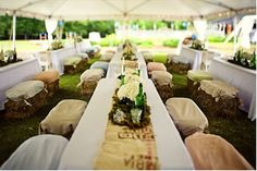 Get creative with your seating. Here hay bales are covered with burlap and cotton covers.