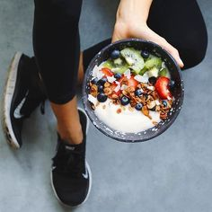 Fuel yourself with some yogurt, fruit, and granola.