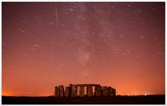 Witness this. A meteor streaks past stars in the night sky over Stonehenge in Salisbury Plain, southern England August The Perseid meteor shower is sparked every August when the Earth passes through a stream of space debris left by comet Swift-Tuttle. Stonehenge, Oh The Places You'll Go, Places To Visit, Beautiful World, Beautiful Places, Beautiful Sites, Jouer Du Piano, Magic Places, Salisbury Plain